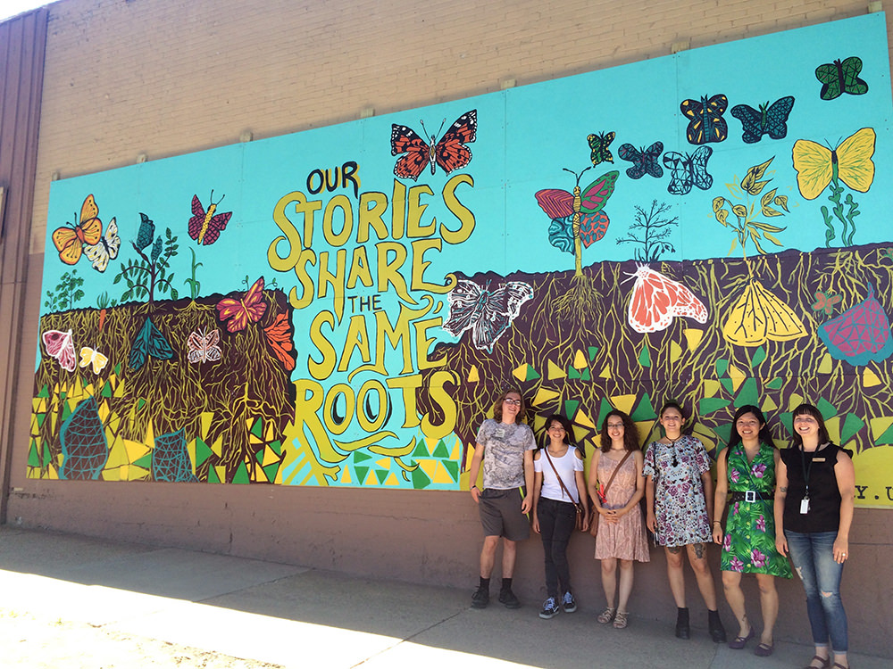 Students and instructors with the mural.